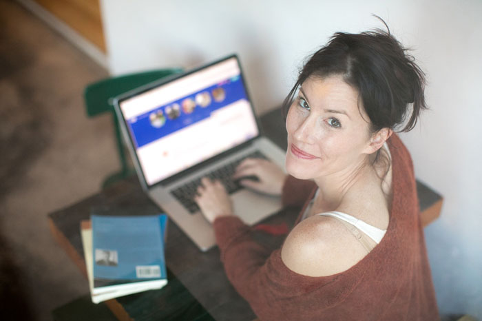 A woman with a laptop
