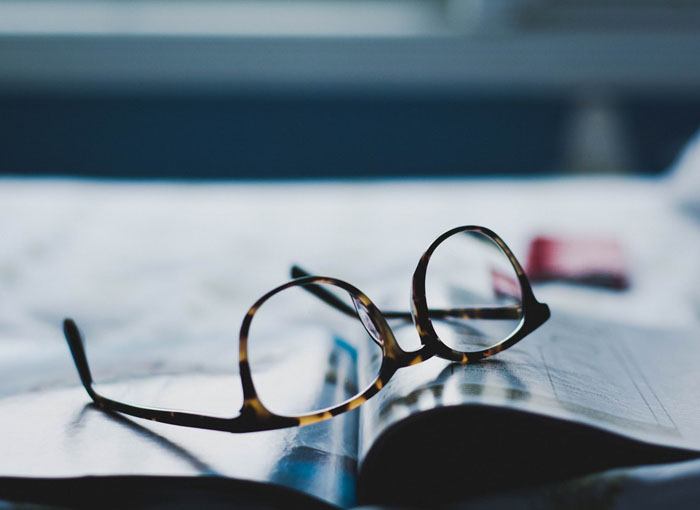 Glasses lying on the book