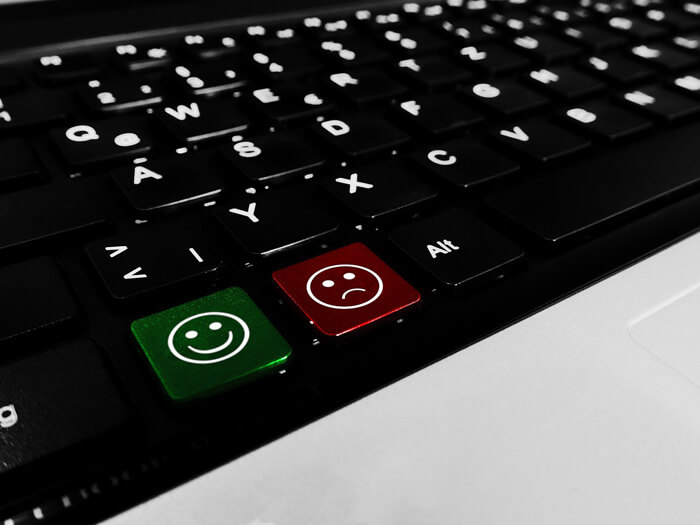 sad and happy laptop buttons banner