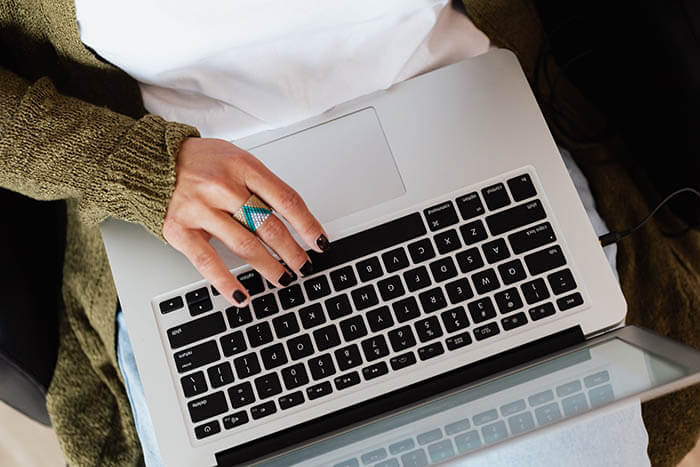 girl with a ring and laptop